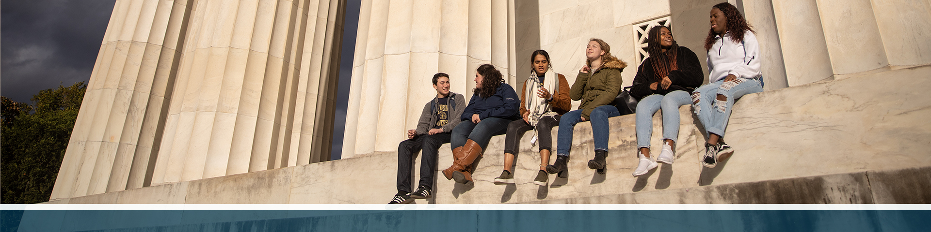 A group of GW students sitting on the national mall